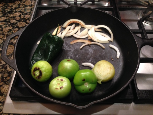 Roasting the ingredients for the green sauce.