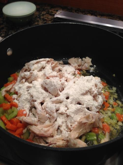 Add chicken and flour.