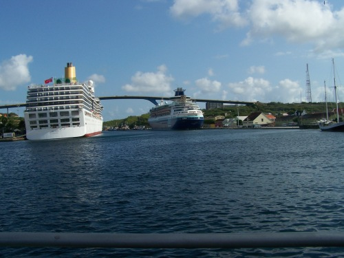 View from pontoon bridge to the Queen Juliana Bridge and two docked cruise ships